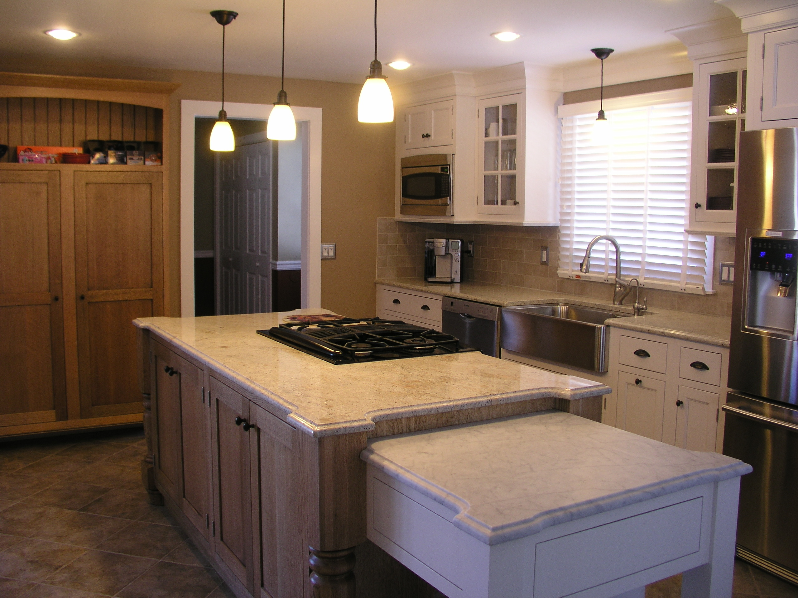 Quarter sawn oak island kitchen design center for Kitchen design center