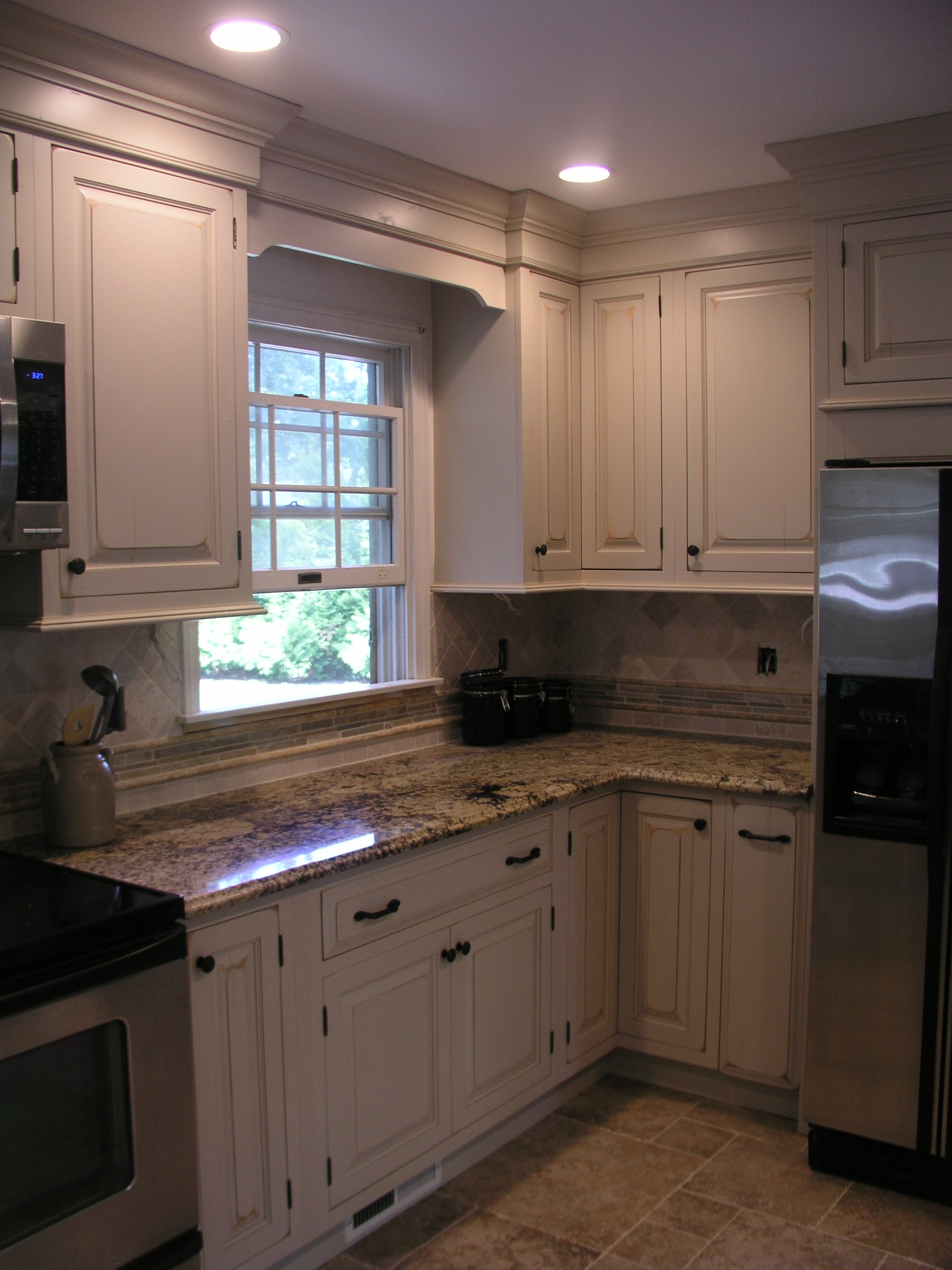 Old world charm for todays modern age family kitchen for Kitchen design center